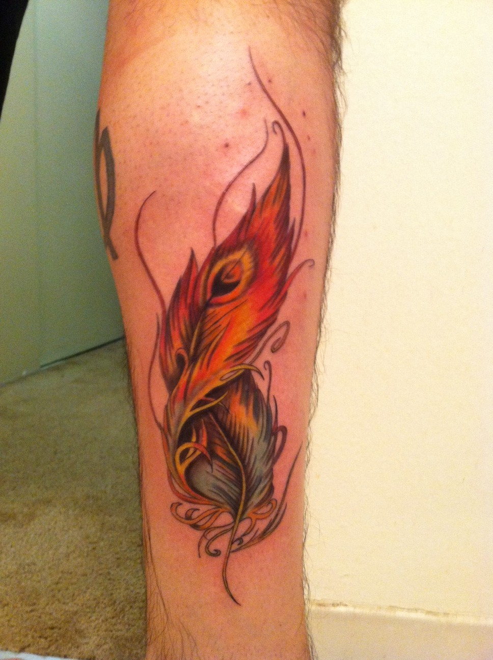30 phoenix leg tattoos ideas for Feather tattoo on thigh