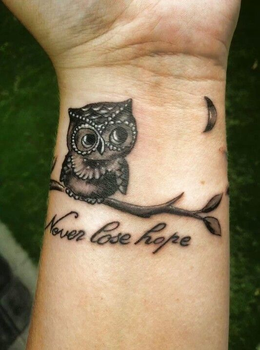 770a0a71576d2 Never Lose Hope - Black Ink Small Owl On Branch Tattoo On Wrist