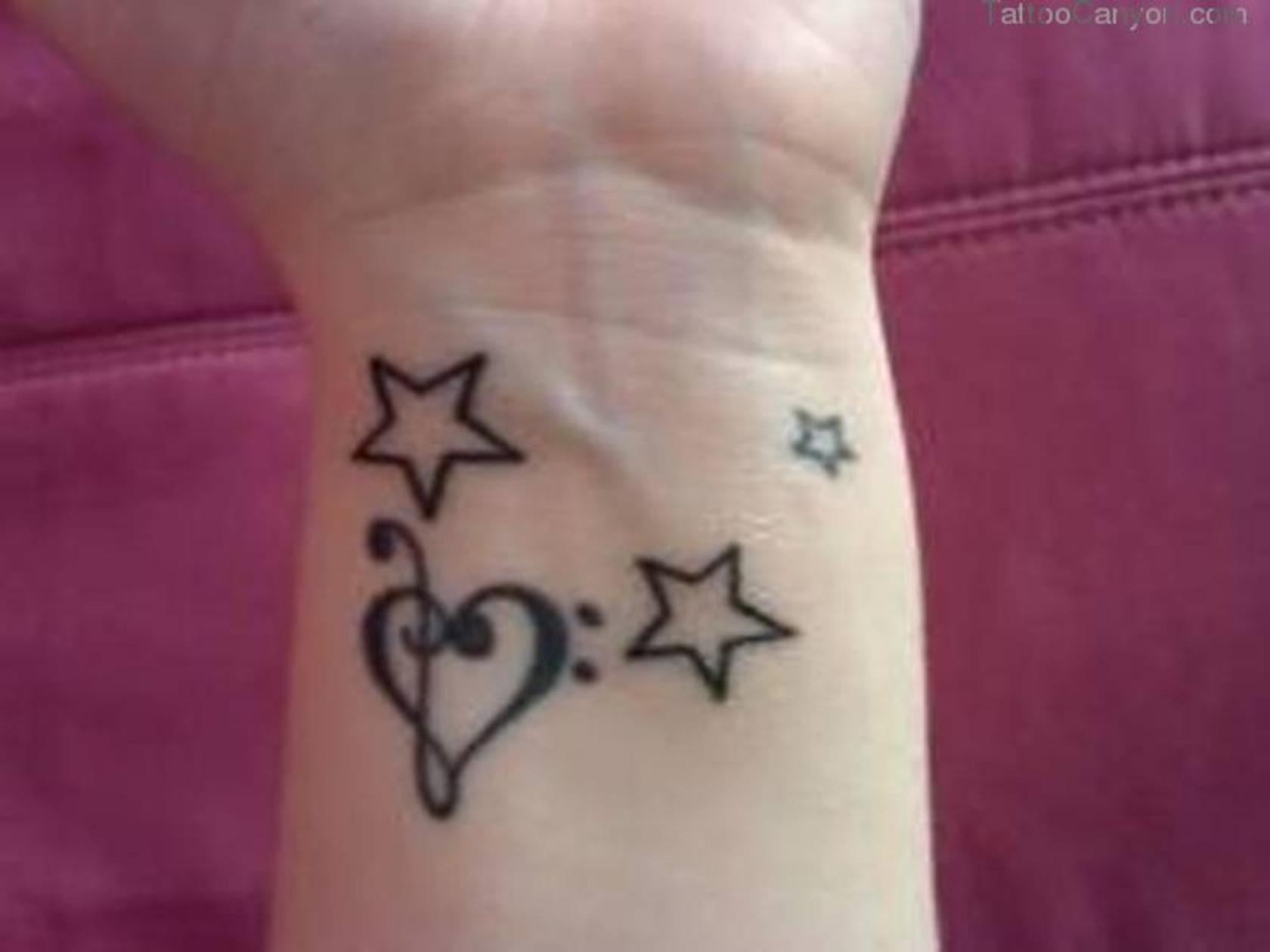 Treble Heart And Star Tattoos On Wrist
