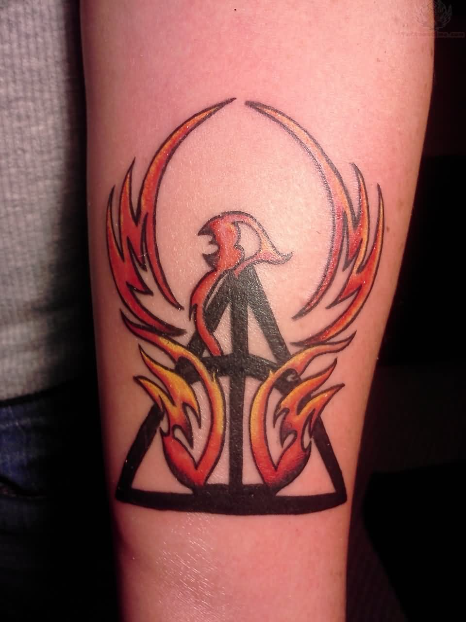 Colorful phoenix tattoo designs - Unique Phoenix With Deathly Hallows Symbol Tattoo Design For Forearm