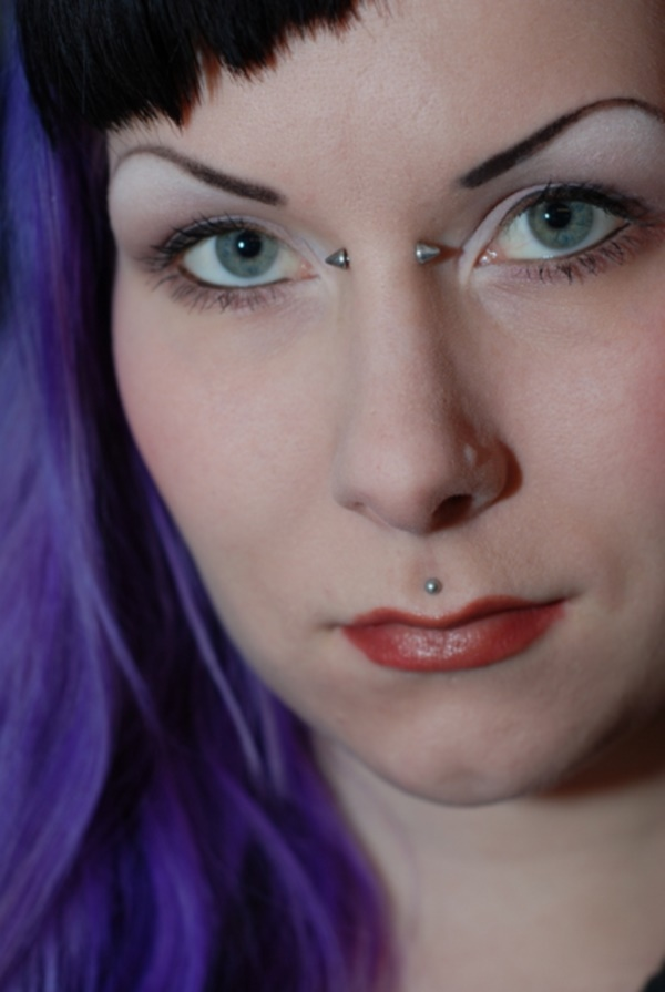 Girl With Bridge And Simple Medusa Piercing