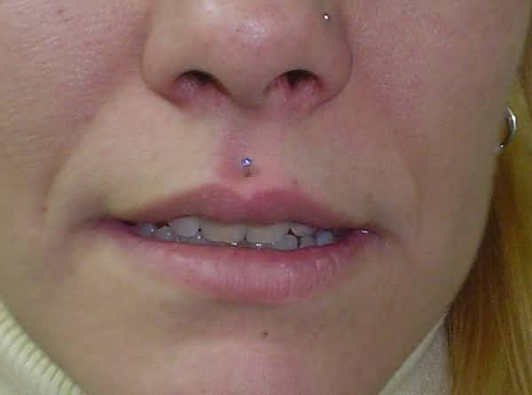 Left Nostril And Medusa Piercing Picture