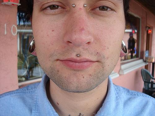 Man with Bridge Piercing And Simple Medusa Piercing