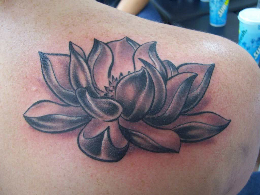 black and white lotus tattoo on right back shoulder