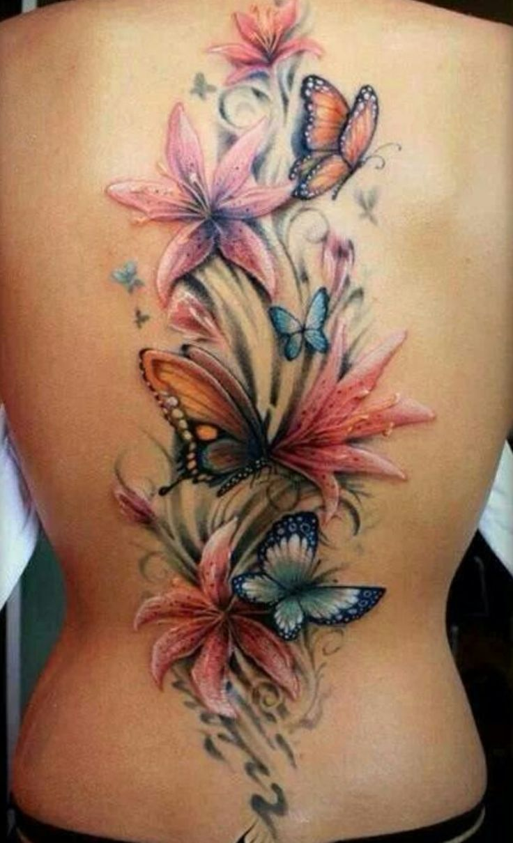 91e6e8ac1 Attractive Colorful Lily Flowers With Flying Butterflies Tattoo On Full Back