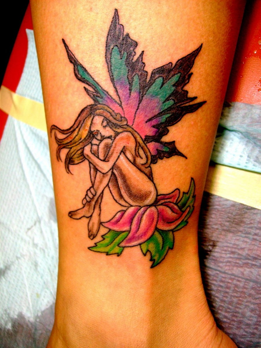 Image result for fairy tattoo with flower