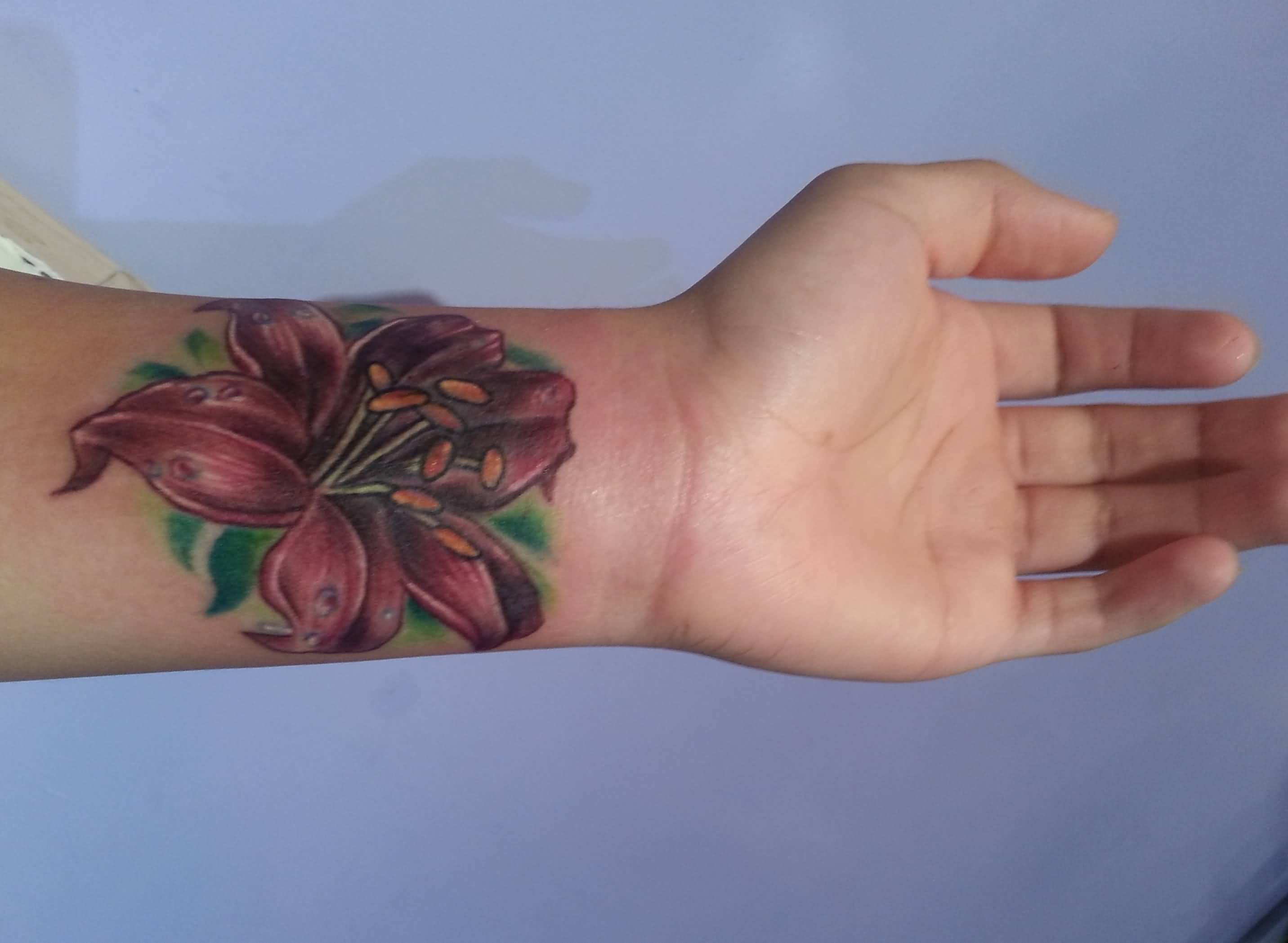 aa5a06f32 Attractive Lily Cover Up Tattoo On Left Wrist