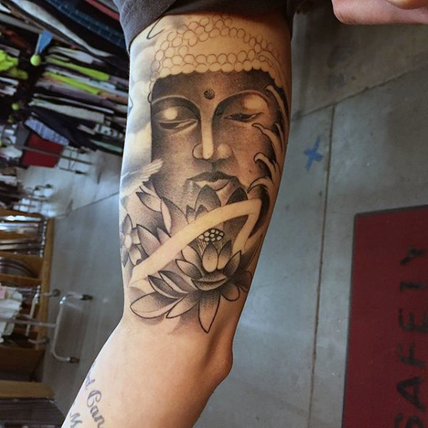 22af040a33540 Black And Grey Buddha Head With Lotus Flower Tattoo On Bicep