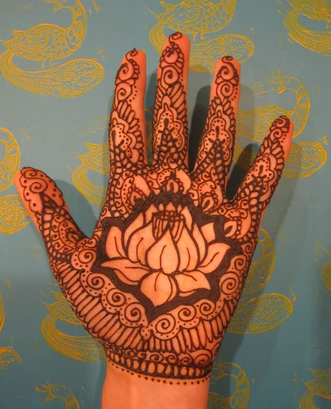 33 best henna lotus tattoos designs black henna lotus flower tattoo on left hand palm izmirmasajfo Image collections