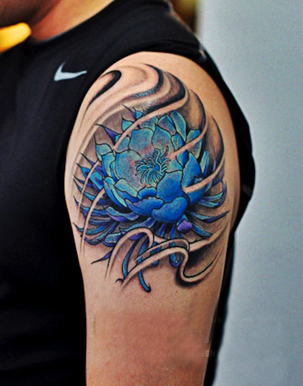 Blue ink japanese lotus flower tattoo on man left shoulder mightylinksfo