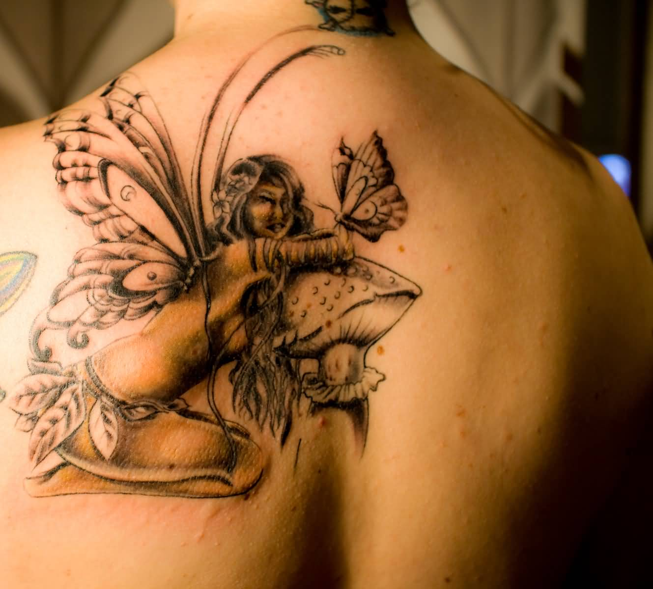 56 fairy tattoos on back for Tattoos on back