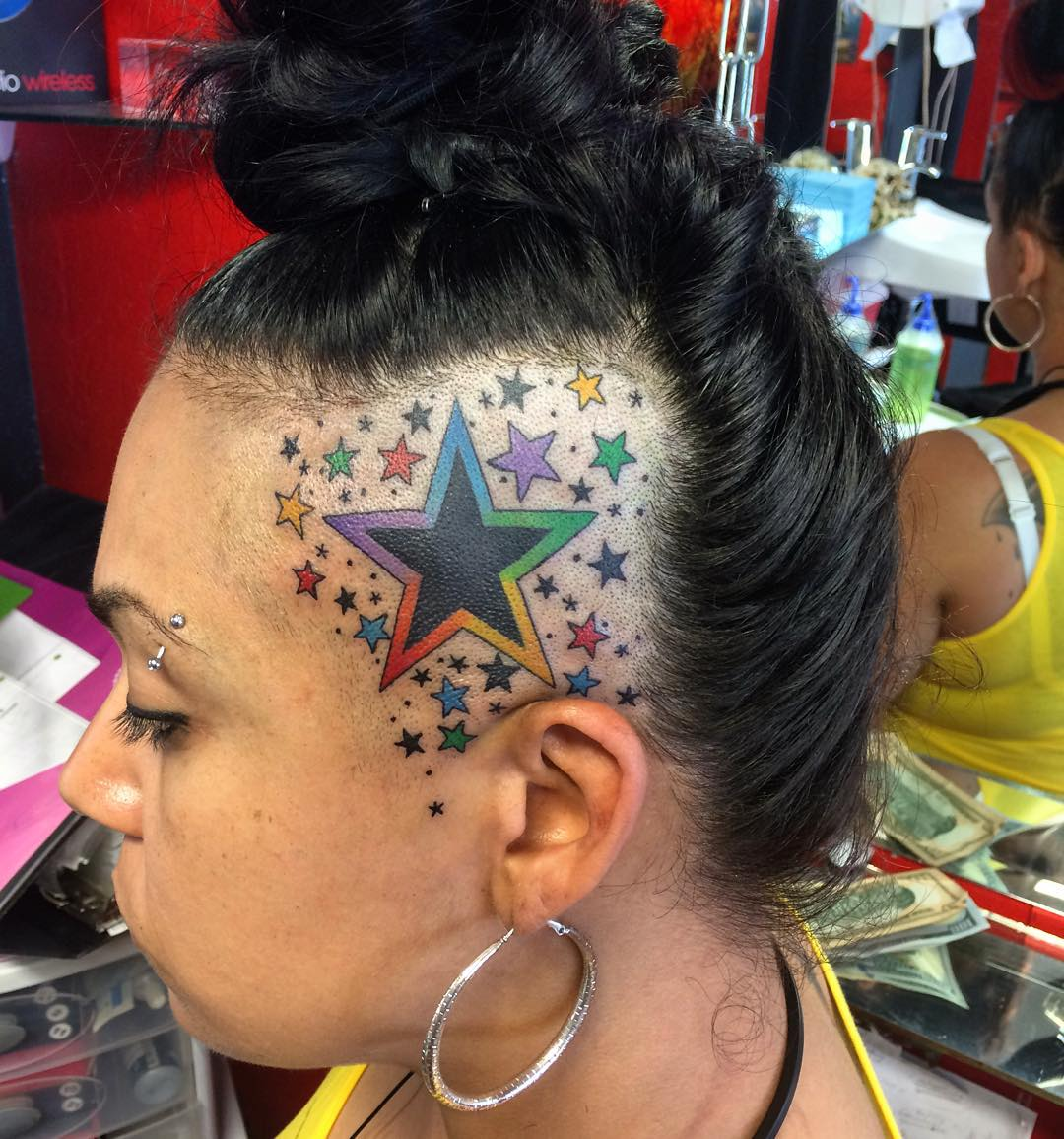 colored stars tattoos on girl head