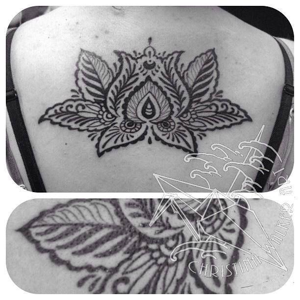 Cool Black Henna Lotus Flower Tattoo On Girl Upper Back
