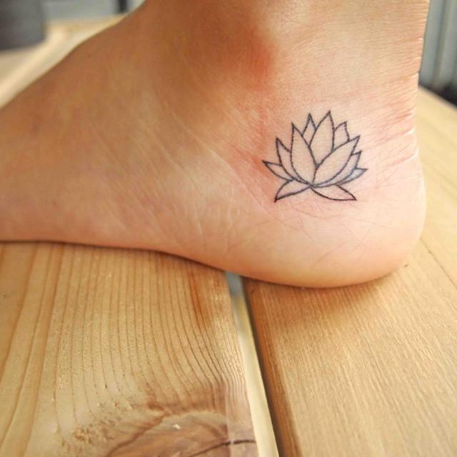 Cool Black Outline Lotus Tattoo On Ankle
