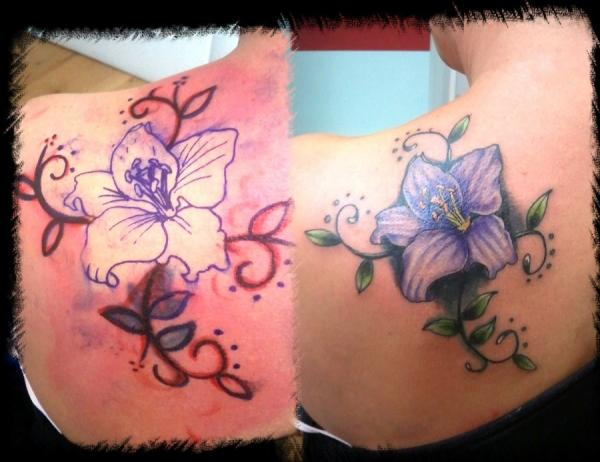 Cool lily cover up tattoo on left back shoulder for Cool cover up tattoos