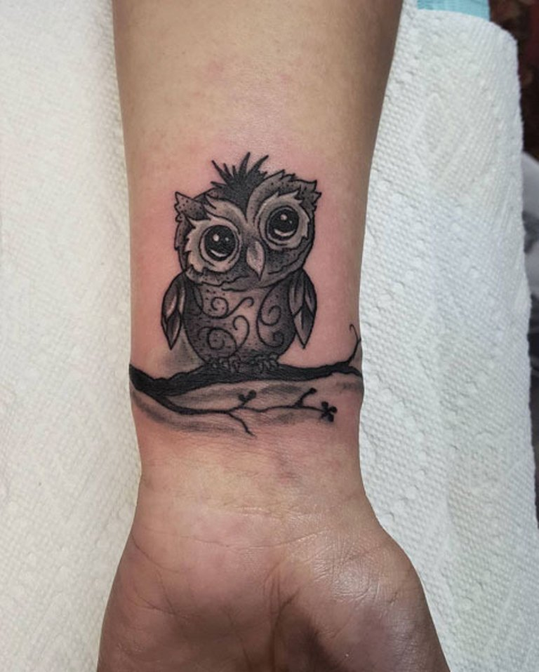 Cute Black And Grey Owl On Branch Tattoo On Right Wrist