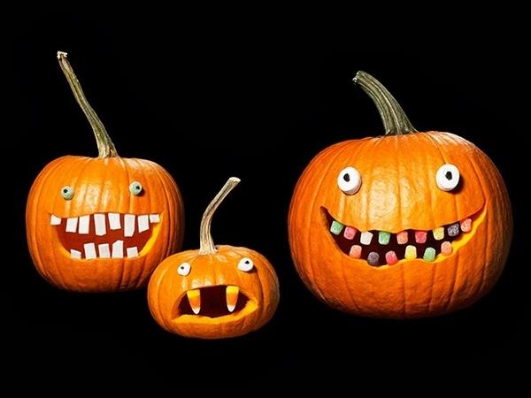 cute pumpkin faces wth candy teeth picture