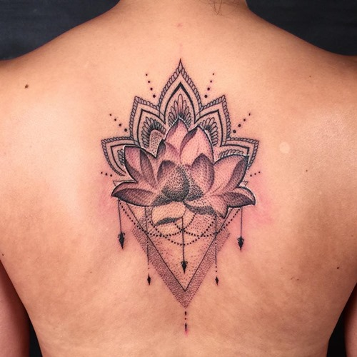 Dotwork lotus flower tattoo on man upper back mightylinksfo