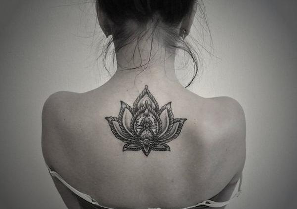 Fantastic black ink lotus flower tattoo on girl upper back by jade fantastic black ink lotus flower tattoo on girl upper back by jade jackson mightylinksfo