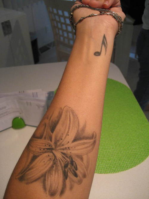 34 Lily Flowers Tattoos On Arm