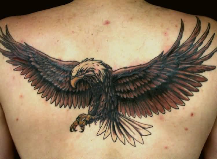 5e151e31546ad Impressive Flying Eagle Tattoo On Man Upper Back