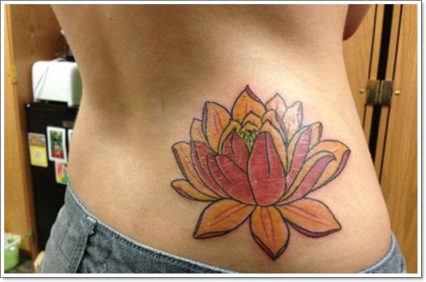 Redhead flower tattoo right pelvis
