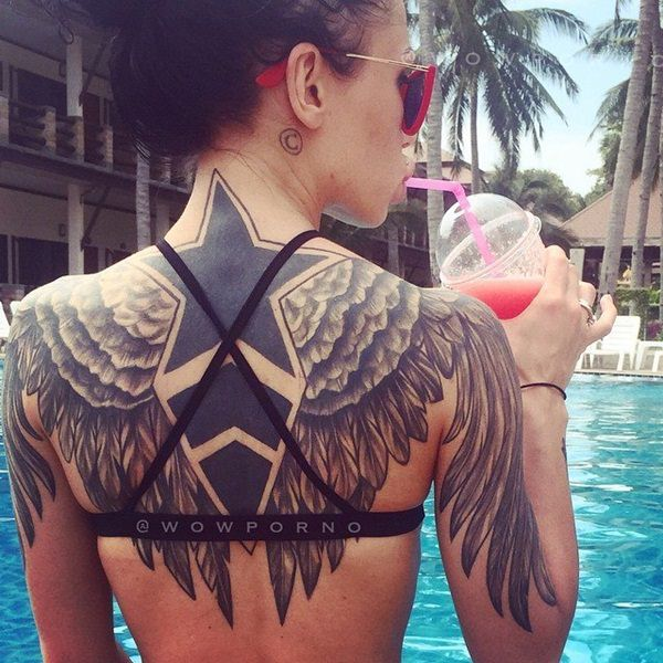 Large Angel Wings And Star Tattoos On Girl Back