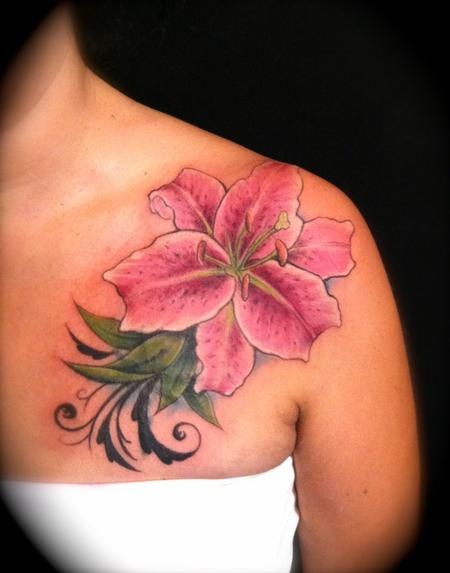 Pink ink lily flower tattoo on left front shoulder by for Pink ink tattoo