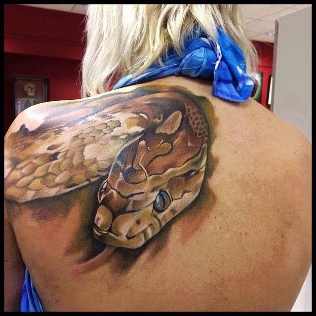 Realistic 3d snake tattoo on girl upper back for Snake tattoo girl