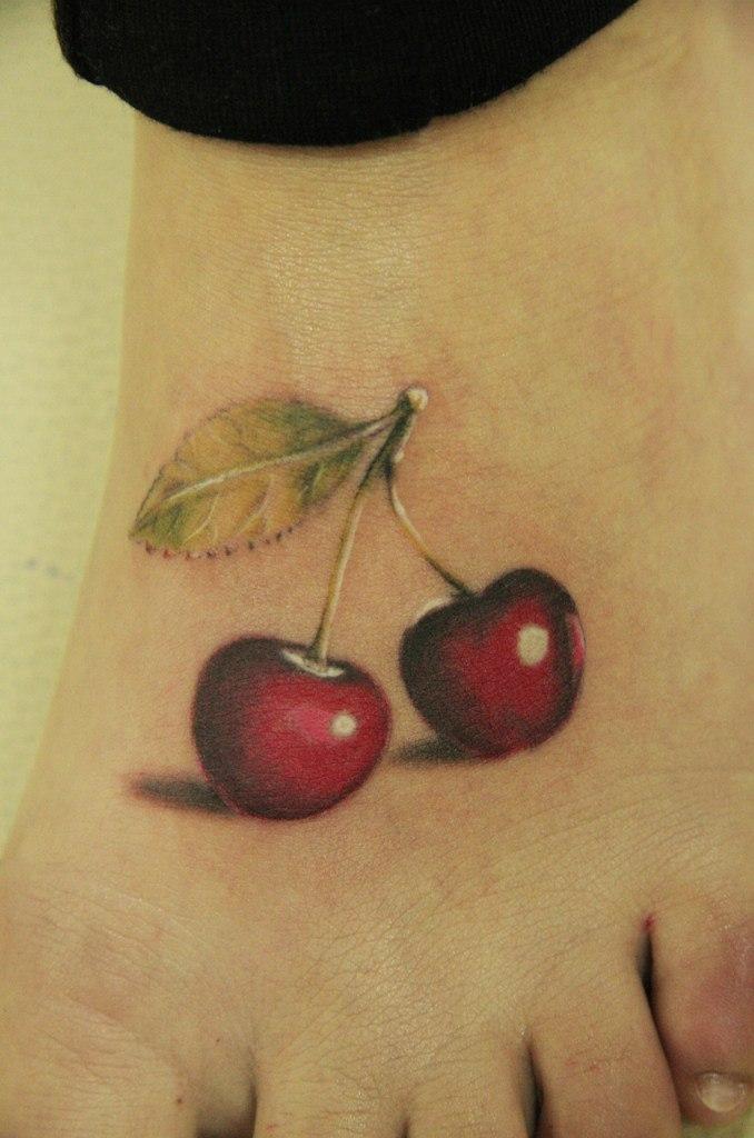 Realistic red cherry tattoos on left foot urmus Gallery
