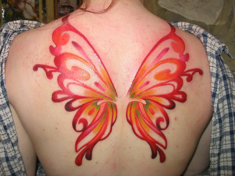 b802c0c1fe4d4 Red Ink Fairy Wings Tattoo On Girl Upper Back