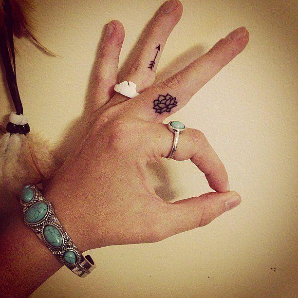 Simple Little Lotus Tattoo On Left Hand Finger