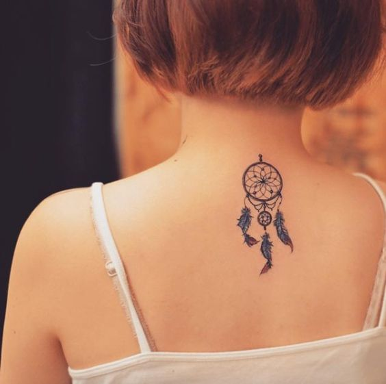 Small Dreamcatcher Tattoo On Girl Upper Back