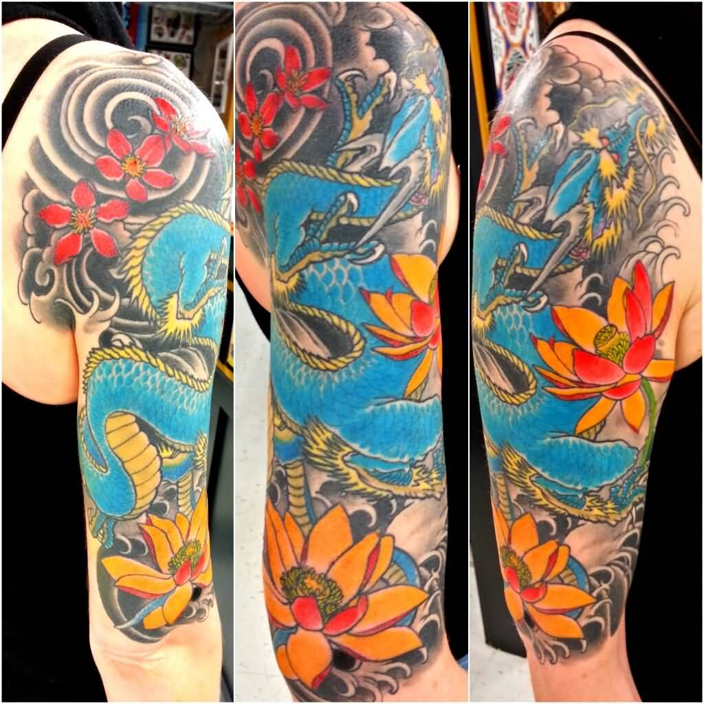 Traditional Dragon With Lotus Flowers Tattoo On Right Half Sleeve