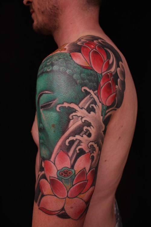Traditional lotus flowers with buddha tattoo on man left half sleeve mightylinksfo