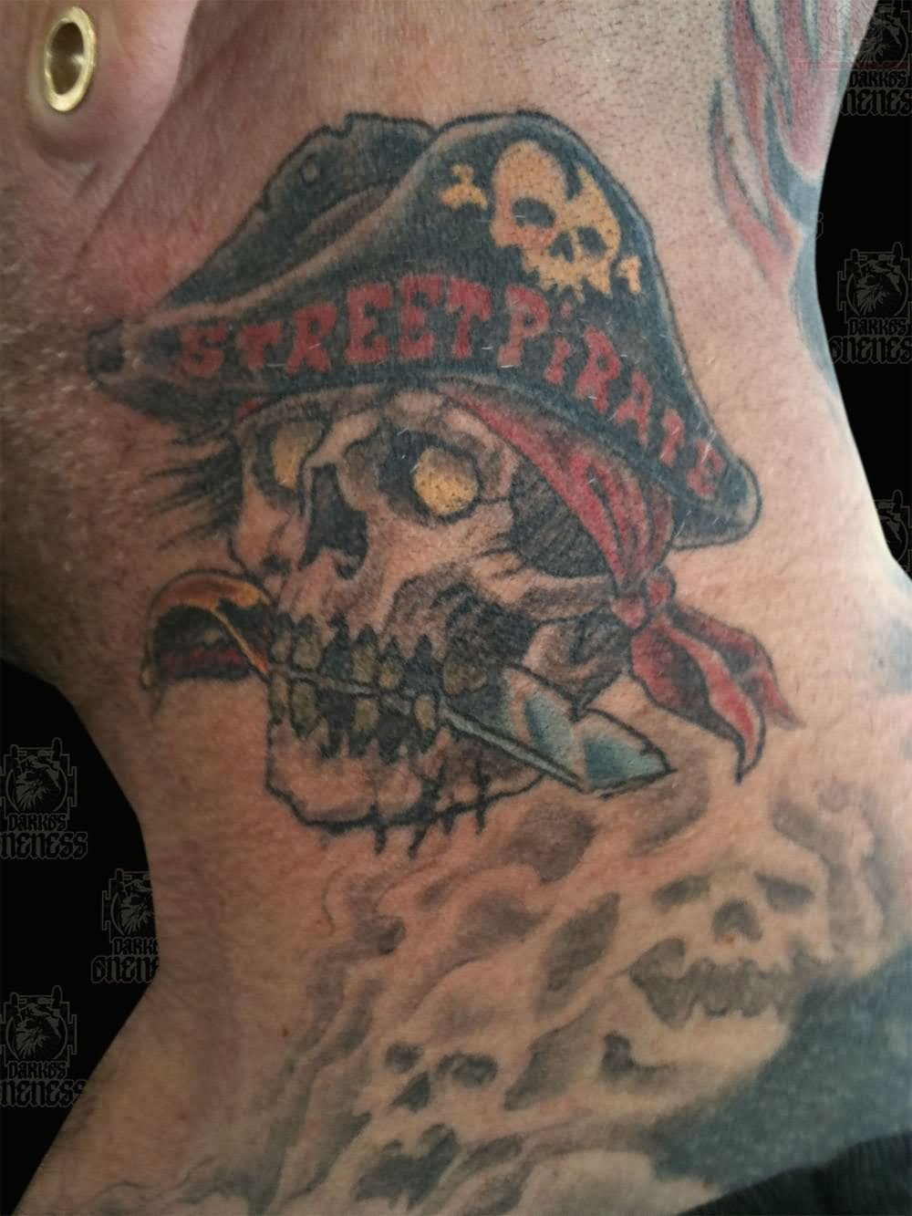 Traditional pirate skull tattoo on man side neck for Skeleton pirate tattoo
