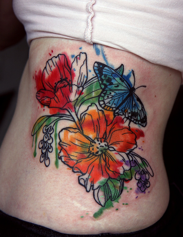2656d7351607f Watercolor Butterfly And Lily Tattoo On Side Rib