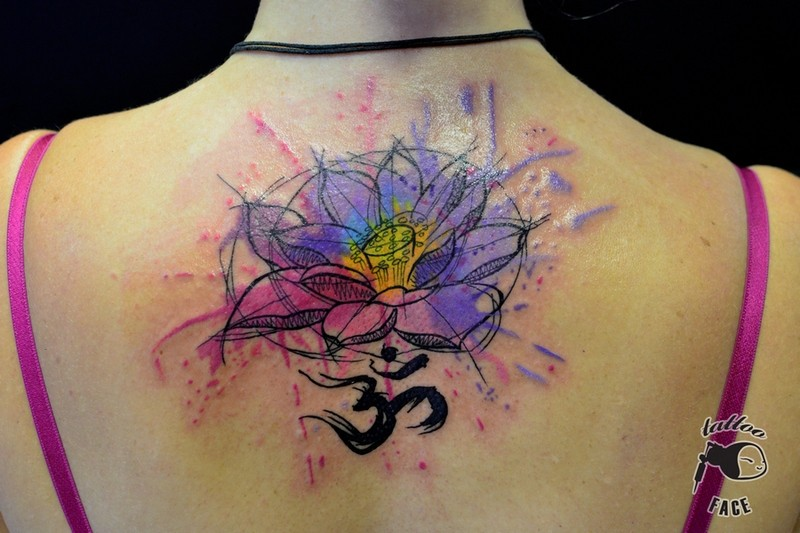 watercolor lotus flower om tattoo on women upper back