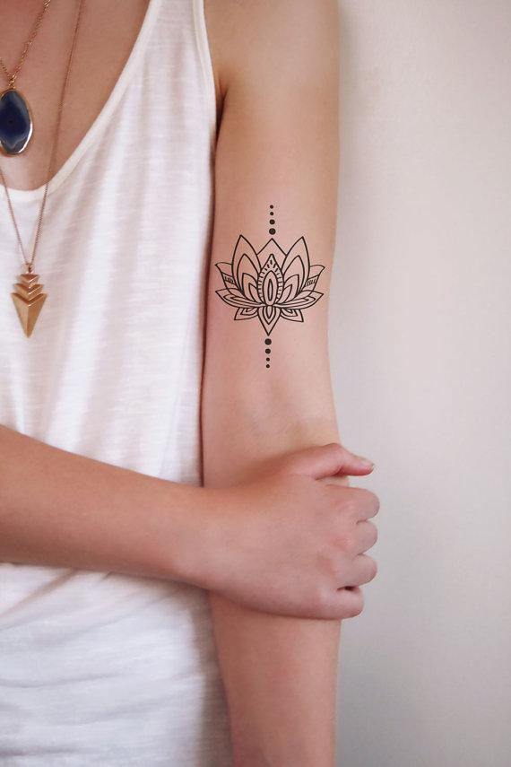 Wonderful Black Outline Lotus Flower Tattoo On Female Left Half Sleeve