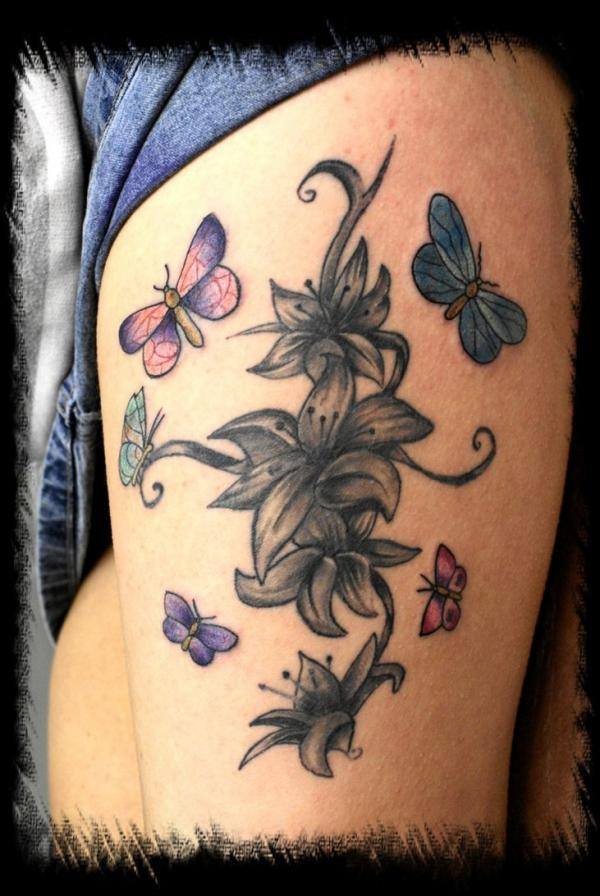 d0f358ab50814 Wonderful Lily With Butterflies Cover Up Tattoo On Girl Left Side Thigh