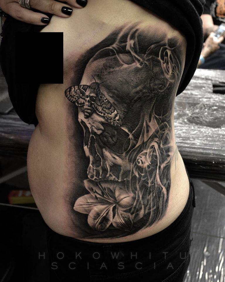 3d Skull With Flower Tattoo On Women Left Side Rib