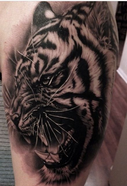 c80781aa16a31 Black And Grey Angry Tiger Head Tattoo On Side Leg
