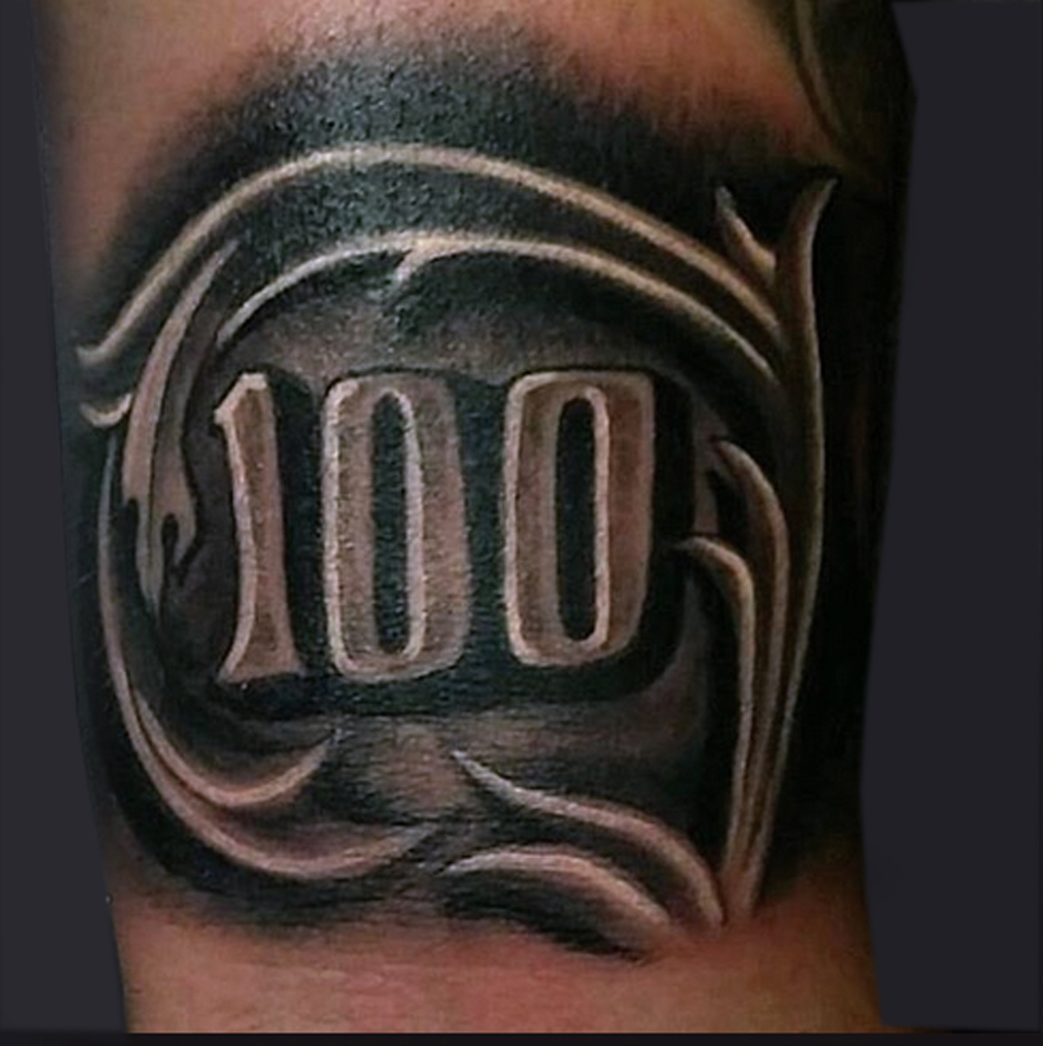 Tattoo Designs Under 100 Dollars: Black Ink Words In Ripped Skin Clover Leaf Tattoo Design