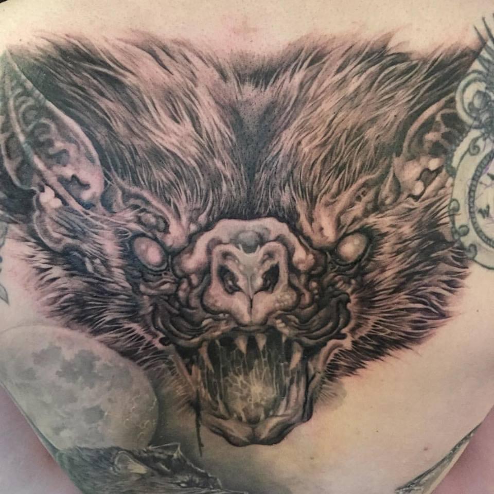 Black Ink Bat Face Tattoo Design For Men