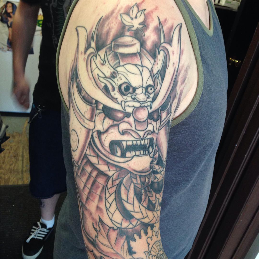 0706b25fe9454 Black Ink Samurai Head Tattoo On Right Half Sleeve