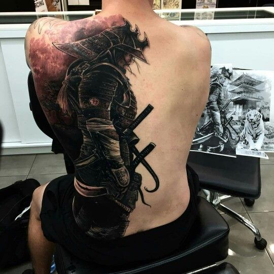 black ink samurai tattoo on man full back