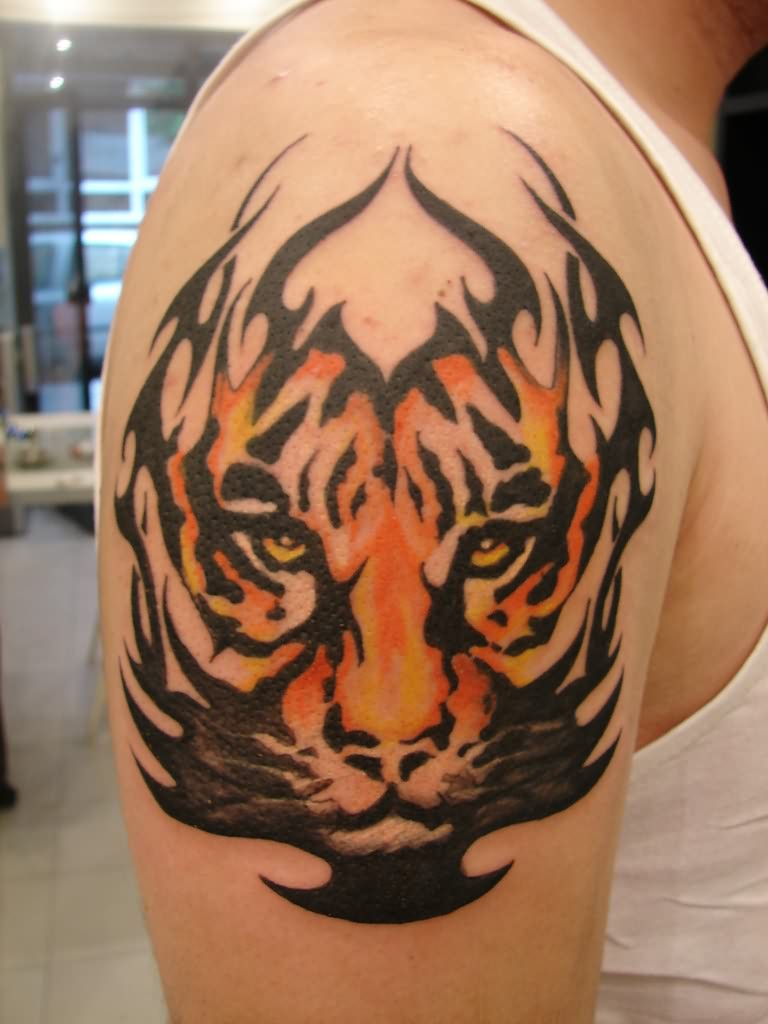 cf8a85a30c73b Color And Tribal Tiger Face Tattoo On Right Shoulder
