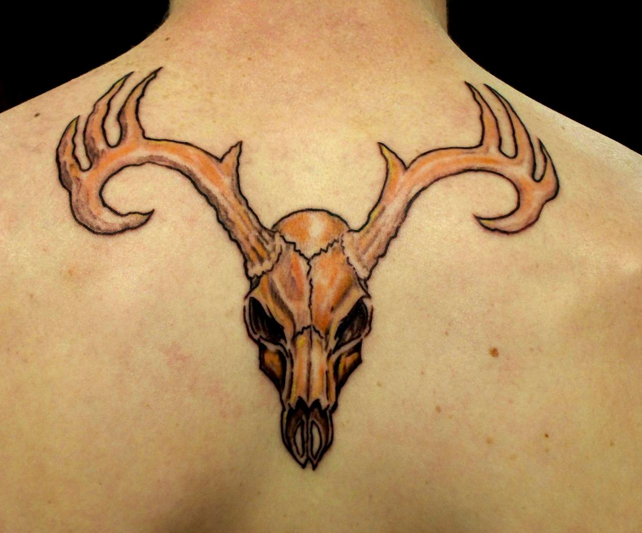 Deer-Antler-Skull-Tattoo-On-Upper-Back.j