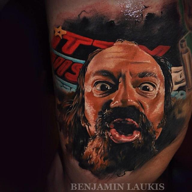 Black And Grey Nas Portrait Tattoo On Left Leg