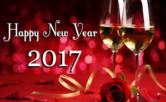 happy new year 2017 wine glasses and rose flower bud